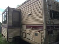 Fifth wheel 1990 King of the Road camper for sale.