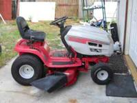 "Huskee Supreme LT 46"" cut riding lawnmower that has a"