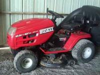 "For sale is 42"" Huskee Lawn Mower. Purchased in 2003,"
