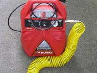 This is a hardly used HUSKY air compressor including