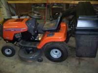 Husqavarna Riding Lawnmower with triple bagger. 15 HP