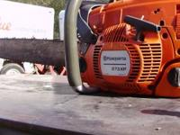 Husqvarna 575 xp Chainsaw with 24in bar. less than two
