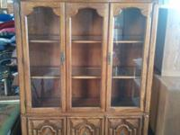 We have a fair cont hutch with glass shelves, double