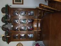 I am asking 2000.00 2 piece lighted bubble glass hutch