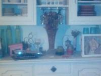 White china cabinet/hutch there is a dark color glass