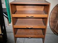 Particle board hutch with 3 shallow pull-out drawers.