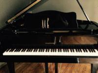 1987 ebony color Hyundai Grand piano.appraised for