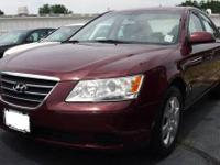 2010 HYUNDAI SONATA DARK CHERRY OUTSIDE, WITH BEIGE