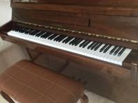 "Used Hyundai upright piano, 45"" in height and 57"" in"