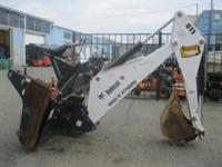 i. 5061 Skid Steer Attachment - Bobcat 811 Backhoe