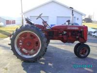 I HAVE FOR SALE A FARMALL C. IT HAS A AFTERMARKET