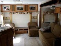 31 foot Fiberglass Exterior travel trailer has: Make me