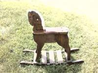 THIS ROCKING HORSE IS ALL WOOD FRIEND OF MINE MADE