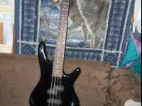 Ibanez bass guitar. Looks good and sounds good. Email