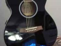 This is a beautiful Ibanez acoustic/electric guitar.
