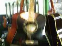 I have a beautiful black Ibanez Acoustic guitar model