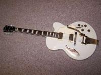 The Ibanez AF75TDG Artcore has an ivory finish and a