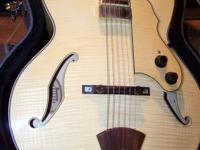 This guitar is in beautiful condition, resembles new.