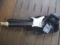 BLACK IBANEZ GIO ELECTRIC GUITAR. LIKE NEW, VERY LITTLE
