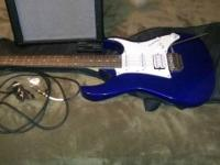 Electric guitar, 15 watt amp, rather new amp cord, and