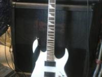 White ibanez electric guitar with dimarzio puckups.