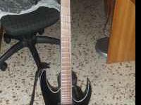 My ibanez mtm 2 with the case. i paid $800 for the