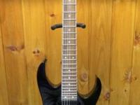 This Ibanez RG7321 7-string Electric Guitar was barely