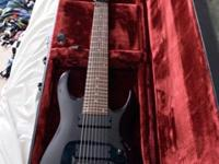 Black 8-string Ibanez with locking nut and EMG
