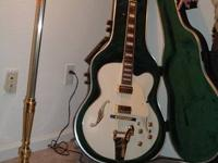 I wish to offer my guitar. It's an Ibanez Jazz Guitar.