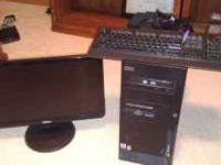 "IBM Pentium 4 Tower with 21"" Dell flat screen monitor."