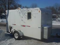 8 hole fish house on wheels.  Has 15,000 btu furnace, 4