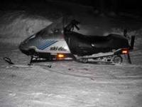 1989 ski-doo,8 by 10 tjlt bed trailer and a medium