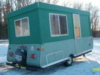 FOR SALE: Popup Camper converted to ice fishing shack.