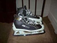 This is a pair of Bauer Supreme goalie skates. They are