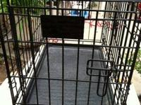 This is a iCrate Double-Door Folding Metal Dog Crate -