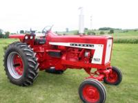 1967 Gas Farmall 706. Restored in 2008. All new tires,
