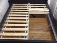 This IKEA Malm series bed frame is two years old and in