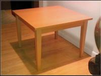 A used IKEA end/coffee table in birch veneer, 24