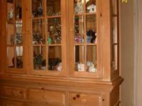 Illuminated cabinet, glass display. large piece of