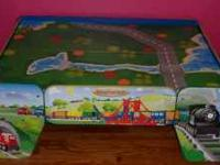 I am selling an imaginarium train table with a pull out