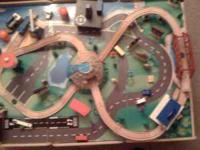Great wooden train table with many track parts and