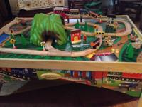 Fantastic train table, tracks, trains, and figurines