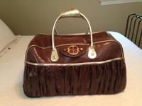 Like new, brown snake skin print with gold trim. A