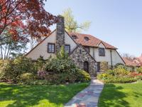 This classic Tudor home sits regally on a 14,000 square