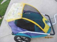 In-Step bicycle trailer. Can transform to stroller.