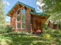 This storybook western log home is located in East