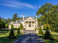 This incomparable neoclassical sits on two plus acres