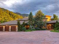 This beautiful custom home is nestled at the base of