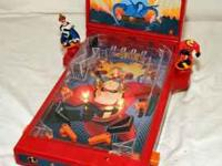 Small toy pinball machine as shown below. In good,