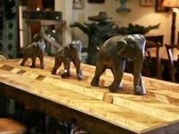 We have beautiful, antique carved Elephants that are
